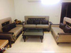 3+2+2 seater sofa with centre table. Good condition.