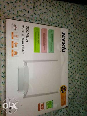 White 300 Mbps Tenda Wireless Home Router Box