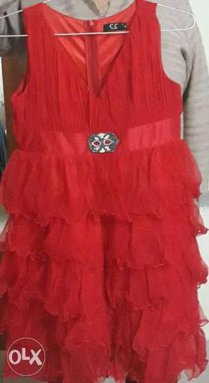 It is red colour party wear frock. It is good for