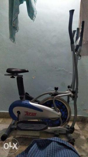 Black, Gray, And Blue Elliptical Trainer