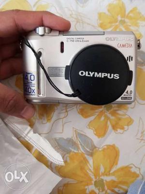 Silver Olympus Digital Camera with wireless remote