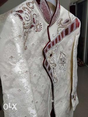 Branded indo western wedding dress.