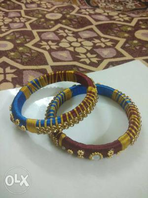 Two maroon gold -and-blue Silk-thread Bangle Bracelets