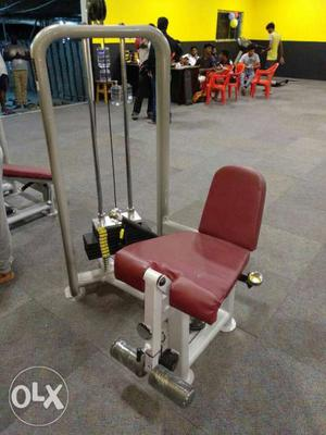 Red And White Metal Exercise Equipment