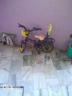 Toddler's Purple And Yellow Bike With Training Wheels