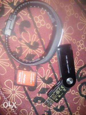 A digital watch, pendrive card reader and a