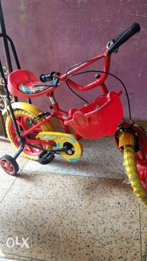 Toddler's Red And Yellow Bicycle With Training Wheels