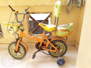 Yellow And White Bicycle With Training Wheels