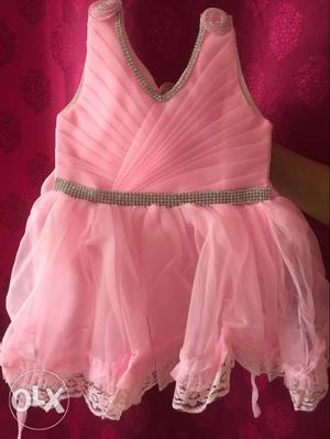 Pink dress with artificial diamond work which