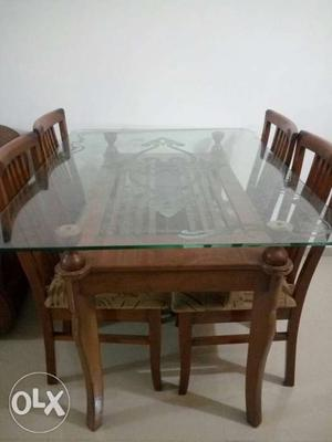 Wooden dining table for four in a very good