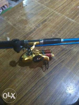 Blue And Gold Fishing Rod With Fishing Reel