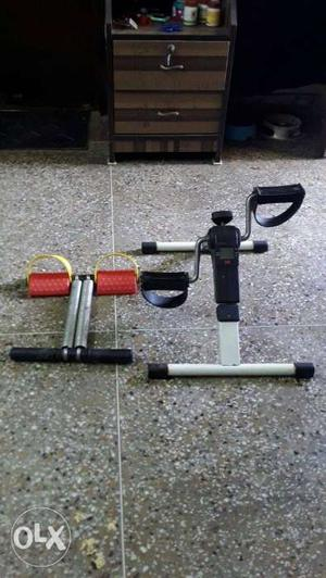 Two Black, Red, And White Exercise Equipment