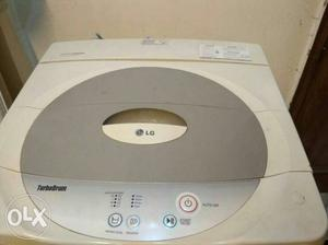 White And Gray Arcelik Top Load LG Washing Machine
