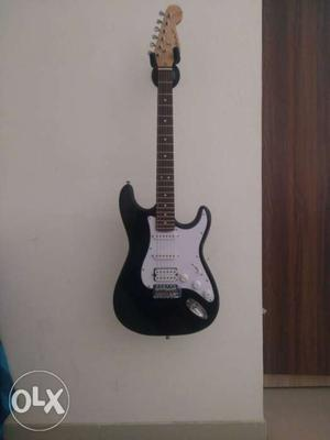 Black And White Stratocaster Electric Guitar.