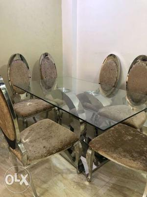 Plastic still on, 6 chairs retail price