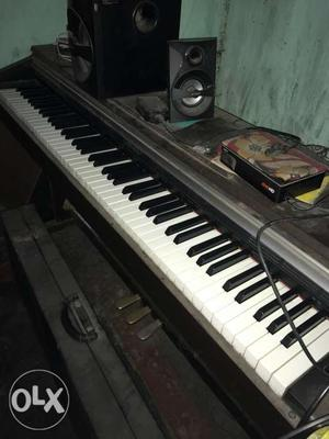 This is an Ap 220 Celviano upright piano with