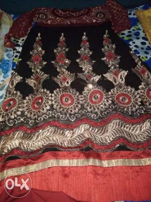 Black, Red, And White Floral Textile