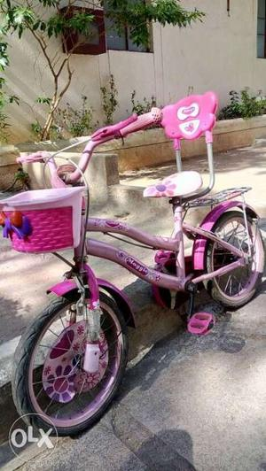Pink And White Bicycle With Training Wheels
