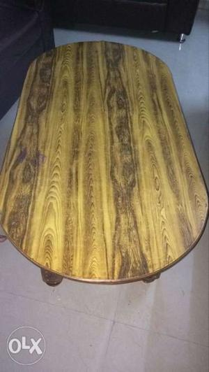 Brown Wooden Oval table with wooden legs