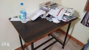 Rectangular Brown Wooden Table With White Metal Base