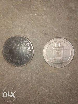 One indian quarter rupee , another american quarter