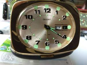 Orient alarm clock with day and date