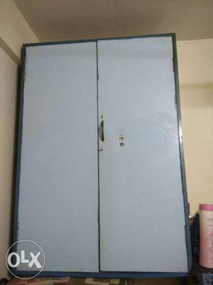 Light blue wall mounted Wooden Wardrobe. Contact number