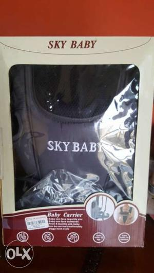 Baby carrier UNUSED to be sold. Greay colour with