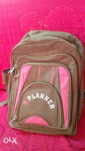 Green colour school bag containing 3 large compartments