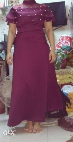 Maroon gown.. Medium size. hurry up.. there for
