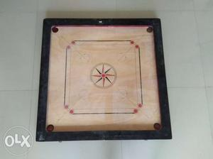Carrom Board with three new strikers up for Sale