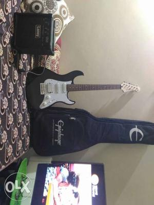 White And Black Electric Guitar And Black Guitar Amplifier