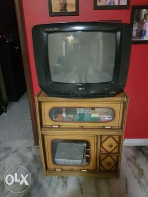 LG colour TV with wooden trolley