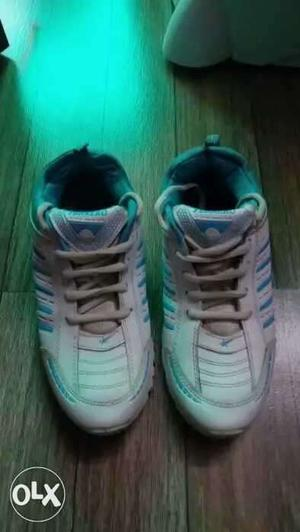 Pair Of White-and-blue shoes 8 no shoes sport shoes
