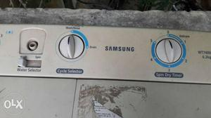 White And Blue Front Load Washing Machine