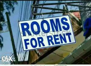 Blue And White Rooms For Rent Signage
