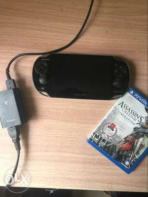 PS Vita  with 8 gb memory card and 2 games