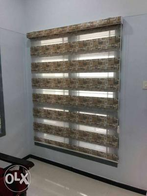 Blinds of different patterns for office and home.