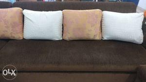 5 Seater sofa, 2 puffies, 6 big and, 2 small cushions, 1