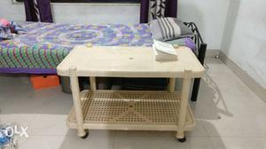 Side table. Spacious plastic table, with wheels