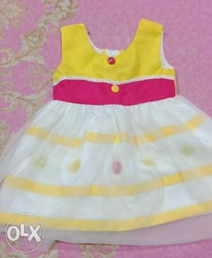 Beautiful yellow and white soft netted frock..for 1 year