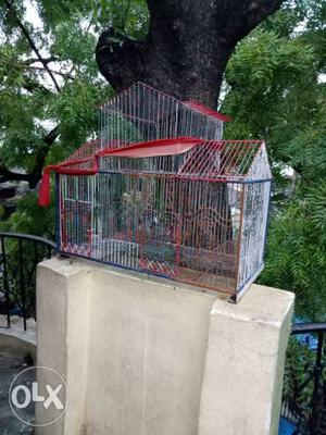 Red And Gray Steel Birdcage