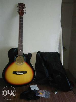 Black and yellow kediance guitar it's not so old