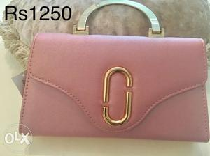 Brand new purse at your door step. available in two colors