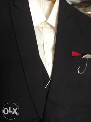 Three piece suit for groom.black suit with off white shirt
