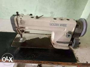 Gray And Black Golden Wheel Sewing Machine