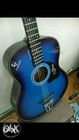 Blue and black acoustic guitar for sale, new