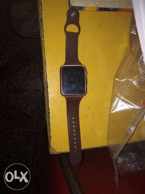 Brown Apple Watch Case With Sport Band