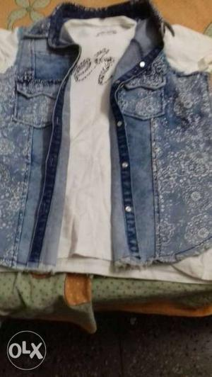 Two jeans jackets new with one white t shirt