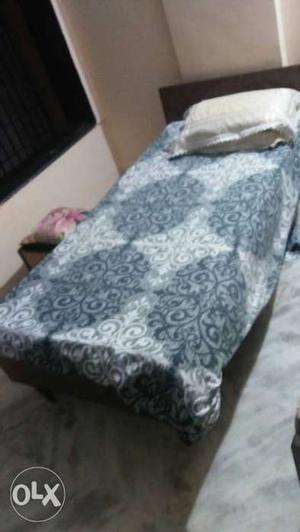 Single wooden cot with mattress and pillow for sale (Good